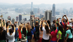 Tourists take a look at Hong Kong from a viewing platform situated at the top of The Peak. 09JUN14