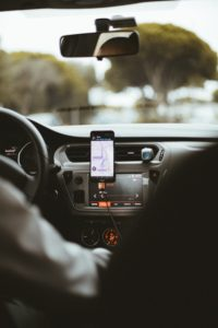 Image of a phone in a car with the Uber app open